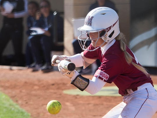 Caity Szczesny, bunts a ball for a base hit against UTEP. Tuesday March 27, 2018.