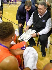 Evansville head coach Marty Simmons talks to his team during a timeout as the University of Evansville hosts Indiana State at the Ford Center Saturday, February 25, 2017.