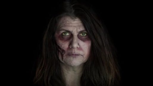 Julie Pope, doing her best zombie, is organizing the Zombie Stomp.Hop.N.Crawl Oct. 31 in downtown Lafayette.