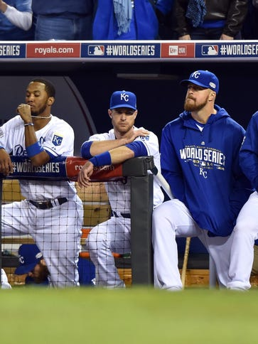 Royals players react from the dugout in the 9th inning.
