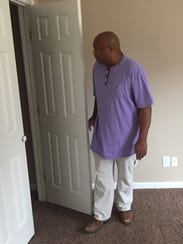 Contractor James Brown shows off the new home he built