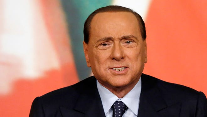 Former Italian Premier Silvio Berlusconi speaks during a press conference at his Forza Italia party headquarters, in Rome, on Nov. 25, 2013.