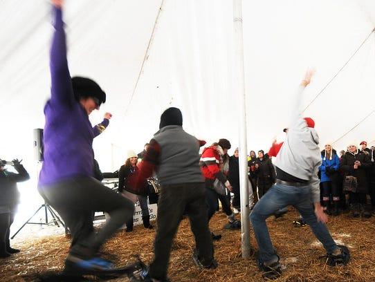 The snowshoe dance contest under the tent has long