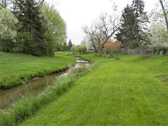 This is what the drainage creek that runs through Mayfair Village subdivision looks like on a normal day.