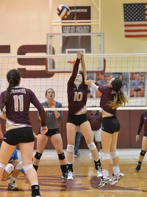 Tuloso Midway's Kelsi Luckenback (1) returns the ball during at District 30-5A match on Tuesday, Oct. 25, 2016 at Calallen High School.