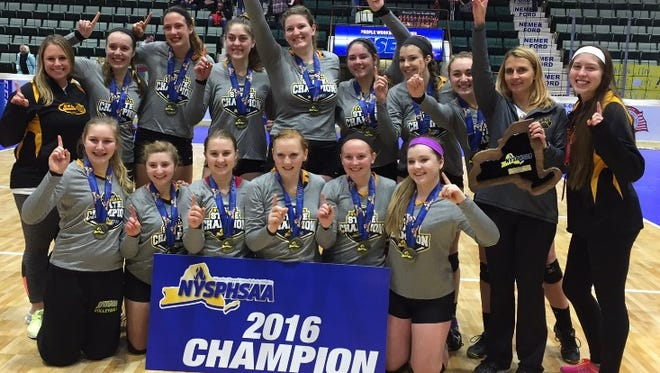 The Honeoye Falls-Lima girls volleyball team poses with the state championship trophy on Nov. 20, 2016.
