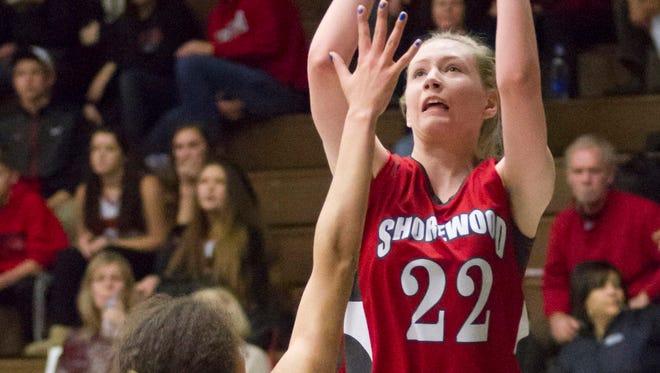 Shorewood center Natalie Tomaszewski takes a shot over Wauwatosa East's Brooklyn Blackburn during the Greyhounds' sectional-semifinal loss in 2017. Tomaszewski helped Shorewood earn a 16-9 record this season.