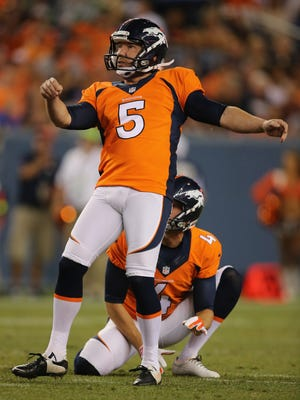 FILE: Denver kicker Matt Prater will miss the first four games of the season for violating the league?s substance abuse policy. DENVER, CO - AUGUST 07:  Place kicker Matt Prater #5 of the Denver Broncos kicks a field goal from the hold of Britton Colquitt #4 of the Denver Broncos against the Seattle Seahawks during preseason action at Sports Authority Field at Mile High on August 7, 2014 in Denver, Colorado. The Broncos defeated the Seahawks 21-16.