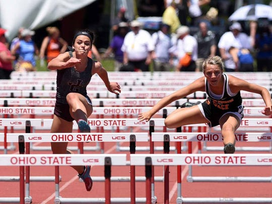 John Glenn's Karlie Zumbro runs in the girls 100-meter hurdles Friday, June 2, 2017, at the state track and field championship at Jesse Owens Stadium in Columbus.