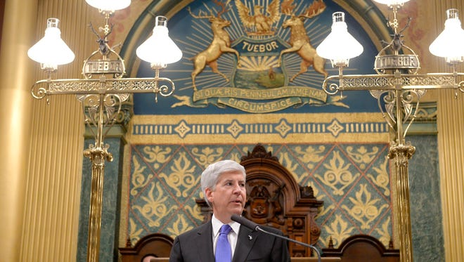 Michigan Governor Rick Snyder speaks during his State of the State Address on the floor of the House at the Capitol in Lansing Tuesday.