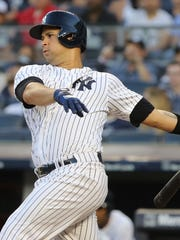 Gary Sanchez, who is making his first appearance back with the Yankees since June 24 due to a stint on the disabled list, flies out in his first at-bat of the game against the Mets on Friday, July 20, 2018.
