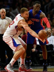 Clippers forward Blake Griffin knocks the ball away from Pistons guard Reggie Jackson during the fourth quarter at Staples Center on Nov 14, 2015.