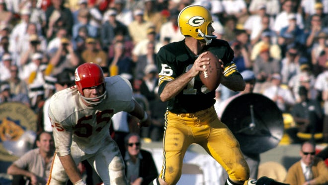 Green Bay quarterback Bart Starr (15) competes against Kansas City during Super Bowl I at the Los Angeles Coliseum in 1967. The Packers defeated the Chiefs 35-10.