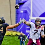 Minnesota quarterback Mitch Leidner (7) passes the ball against Northwestern defensive lineman Dean Lowry (94)  during the second half of an NCAA college football game  in Evanston, Ill. Northwestern won 27-0.