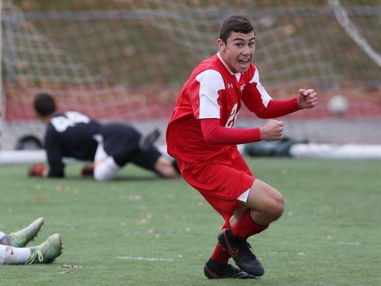 Somers' Andrew Lasher (24) celebrates his game winning