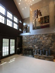 The foyer has 24-foot ceilings and an original fieldstone