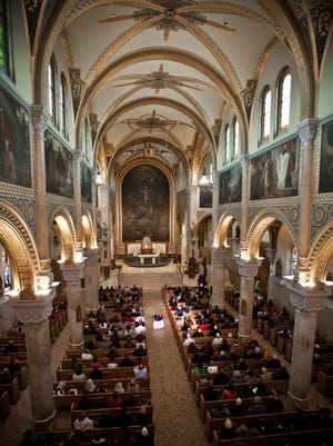 Worshippers fill St. Francis Xavier Cathedral in downtown Green Bay to hear Bishop David Ricken during Mass in 2013.