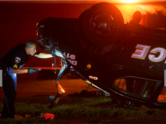 Emergency crews work the scene on Sherman Street at Edison Street in York where at least two York city police vehicles were involved in an accident Wednesday, October 7, 2015. One vehicle flipped on its hood, another caught fire according to bystanders.