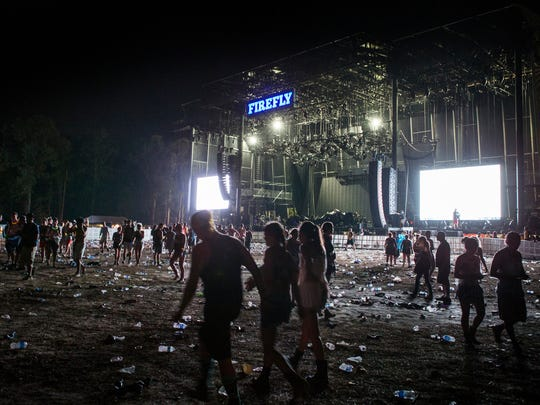 Fans leave the Main Stage as they evacuate the Firefly grounds because of weather in 2015.