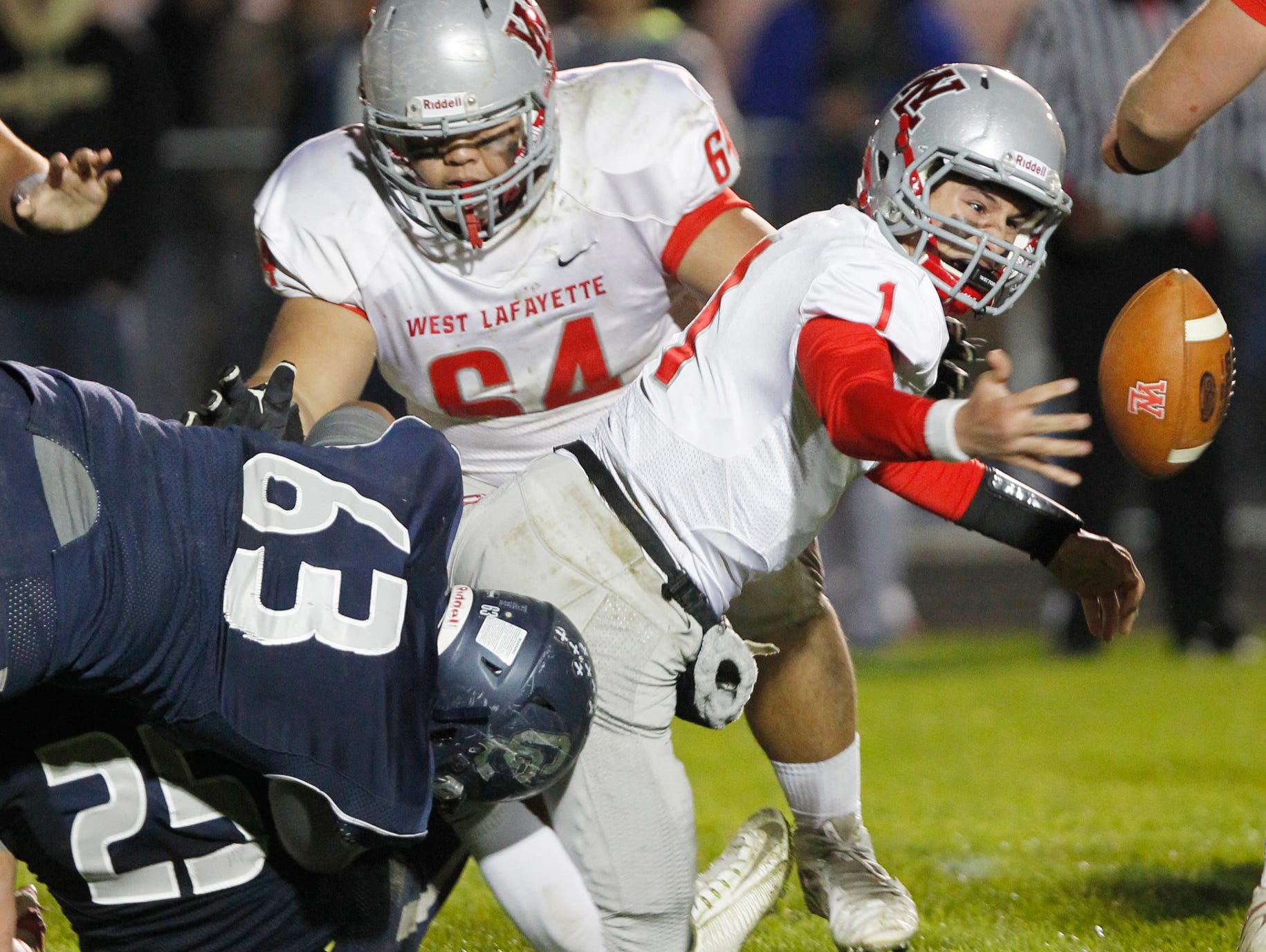 West Lafayette's Mikey Kidwell fumbles the ball as he is hit by Central Catholic's Rizlyon Baguisa with 9:49 remaining. CC beat their conference rival 38-20.