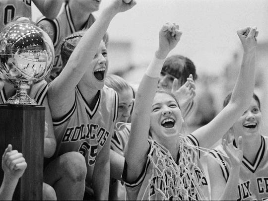 Christi Hester, right, wore the net around her neck as she celebrated with her teammates after winning the Girls 'A' tournament in Richmond.