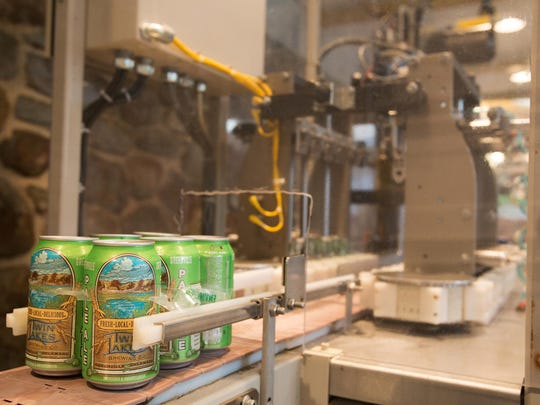 In this 2013 photo, a six-pack of Twin Lakes Pale Ale sits at the end of the assembly line near the six-packing machine at the brewery.