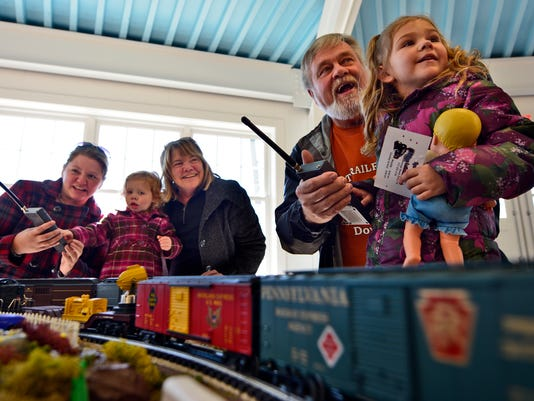 Running trains is a family affair for Kristen Pettman, left of Dover, her parents Sandy and Tom Landis, and daughters Evelyn, 3, and Marie,4,  during the sixth annual Back on Track Fest at Brookside Park in Dover, Sunday Nov. 15, 2015. This year's event, sponsored by Salem Lutheran Church in Dover, benefits local cancer patient Colleen Livingston who is battling Non-Hodgkins Lymphoma.