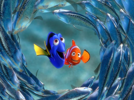 Dory and Marlin are surrounded by moonfish in this scene from The Walt Disney Co.'s animated film 'Finding Nemo.' AMC Loews Theatres offer opportunities to watch films with the lights up and the sound down.