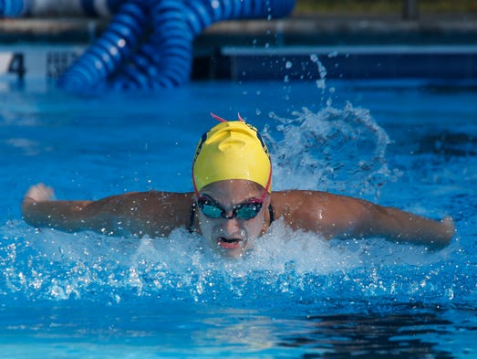 Erica Sliverman, 17, a member of the Horace Greeley swim team, works out at the Birchwood Swim and Tennis Club in Chappaqua on  Aug. 26, 2014.