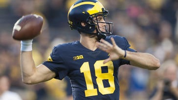 UM QB Peters still in protocol, but 'getting better'