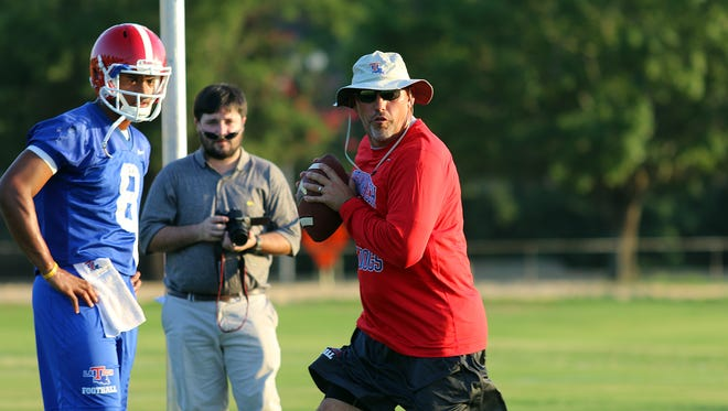 Louisiana Tech assistant Tony Petersen, right, is the second-highest paid offensive coordinator in Conference USA.