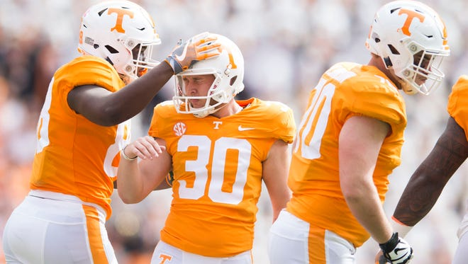 Vols placekicker Brent Cimaglia (30) is congratulated on his second field goal of the game Saturday against South Carolina.