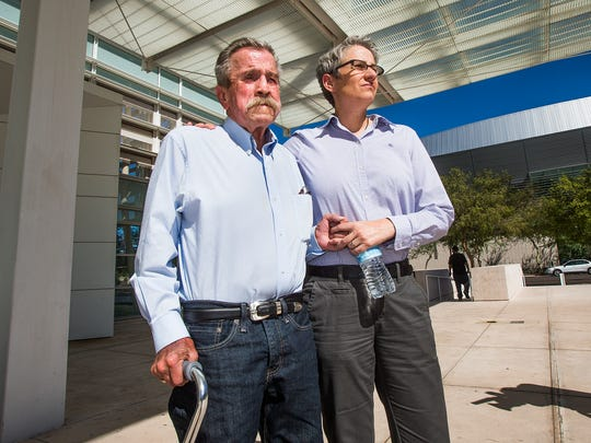 Fred McQuire (left) and friend Therese Sadorf stand outside the Sandra Day O'Connor U.S. Courthouse in downtown Phoenix before heading into court on Sept. 12, 2014.  McQuire, whose partner George Martinez died earlier this month, is requesting the courts to recognize their marriage.