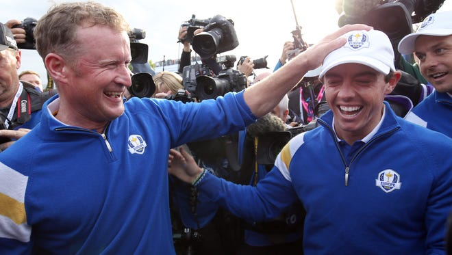 Europe?s Jamie Donaldson, left, and Rory McIlroy celebrate winning the 2014 Ryder Cup golf tournament at Gleneagles, Scotland, Sunday, Sept. 28, 2014. (AP Photo/Peter Morrison)