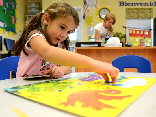 Belle Navarrette, 5, plays with the Sunny Day Pond toy set during class at The Goddard School in Sparks  on Monday, Oct. 6, 2014.