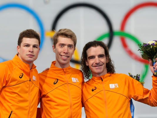 In this Tuesday, Feb. 18, 2014 file photo athletes from the Netherlands, from left to right, silver medallist Sven Kramer, gold medallist Jorrit Bergsma, and bronze medallist Bob de Jong stand on the podium during the flower ceremony for the men's 10,000-meter speedskating race at the Adler Arena Skating Center during the 2014 Winter Olympics in Sochi, Russia. Count on the Dutch to dominate the oval at the PyeongChang Olympics, but don't expect them to suffocate opposition like they did in Sochi four years ago.  They turned the Olympic hall into a sea of their national color, orange, courtesy of a massive haul of 23 of 36 medals, including eight out of 12 golds. (AP Photo/Patrick Semansky, File)