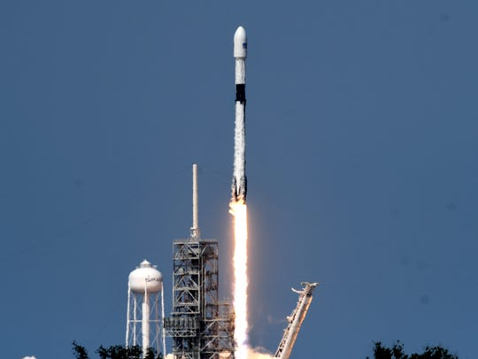 A SpaceX Falcon 9 rocket lifts off from Kennedy Space