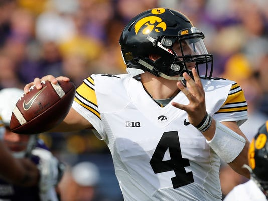 Iowa's Nathan Stanley makes a pass against Northwestern during the first half of an NCAA college football game Saturday, Oct. 21, 2017, in Evanston, Ill. (AP Photo/Jim Young)