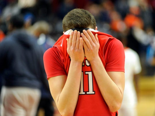 Josh Brown of Cherry Hill East reacts at the end of Sunday's the Group 4 state final at Rutgers Athletic Center, Piscataway NJ