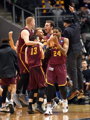 The Loyola Ramblers celebrate after defeating the Kansas State Wildcats in the championship game of the South regional of the 2018 NCAA Tournament at Philips Arena.