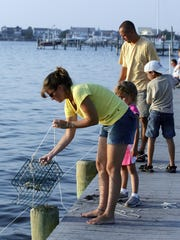 A family is shown crabbing at Bayside Park in Brick