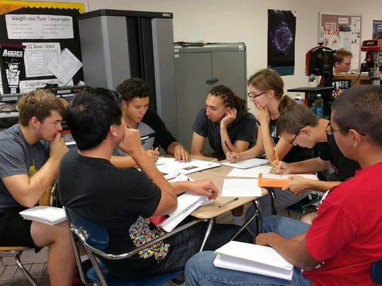Alamogordo High School's MESA students brainstorm together before competition.
