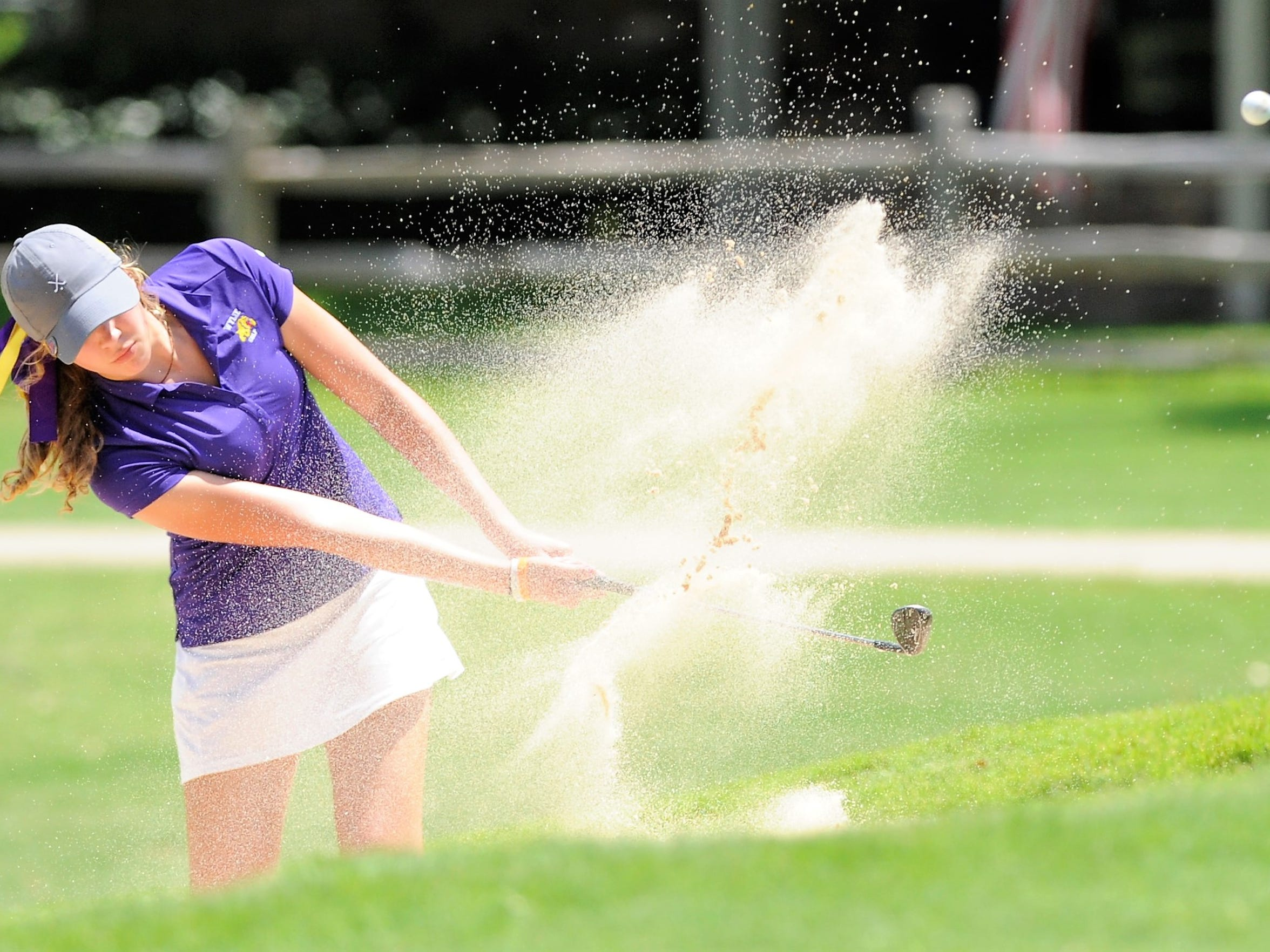 Wylie's Maddi Olson shoots out of a bunker during the