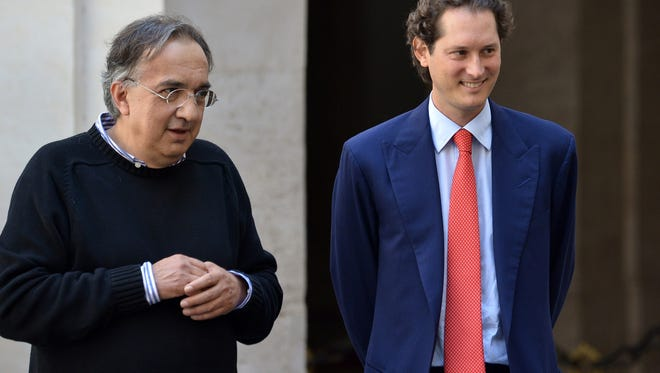 Fiat Chrysler Automobiles CEO Sergio Marchionne (left) and Fiat chairman John Elkann during a presentation in Rome July 25, 2014.
