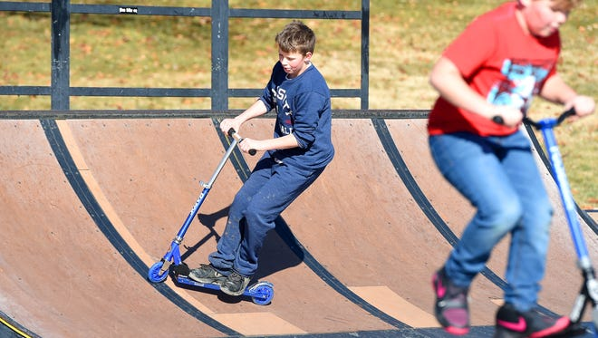 Priest Kirk, 11, of Staunton practices performing stunts on the scooter he got for Christmas. He joins friends having fun together on an assortment of bikes and scooters at the action skate park at Gypsy Hill Park on Thursday, Dec. 29, 2016.