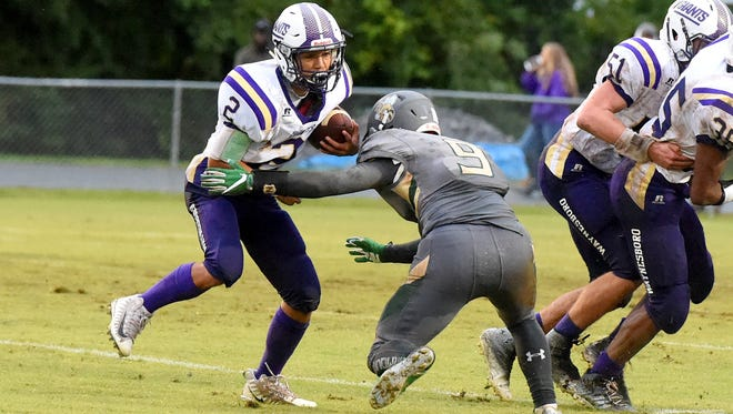 Waynesboro's Tyler Cabell looks for a way around Wilson Memorial's Taylor Evans who goes for a tackle during a football game played in Fishersville on Friday, Sept. 1, 2017.