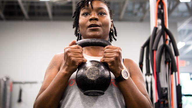 Lashell Abston works out during a fitness class Thursday, July 26, 2018, at the New Beginnings Center in Nashville.