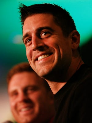 Green Bay Packers' quarterback Aaron Rodgers smiles while talking during Clubhouse Live with John Kuhn at the Radisson Paper Valley Hotel on Monday, December 30, 2014 in Appleton, Wis.