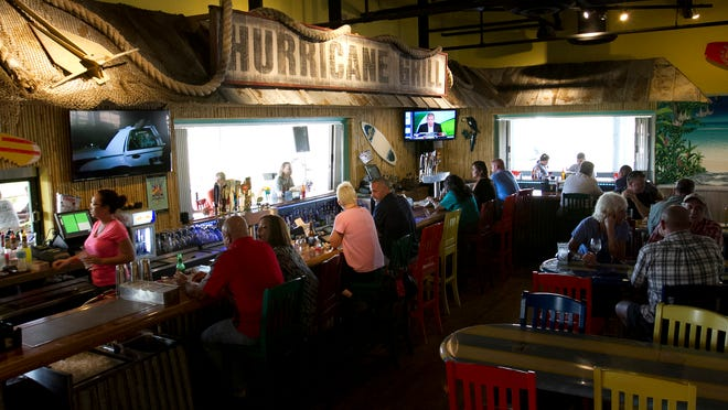 The Hurricane Grill & Wings in Cape Coral has been open six months. Its size and layout conforms to the company's latest design, and is much bigger than stores that opened last decade.