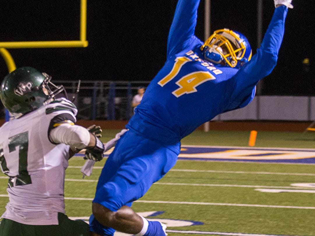 Oxford's DK Metcalf leaps for the pass as West Point's Randall Johnson defends.